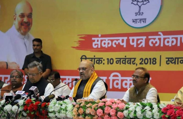 BJP National president Amit Shah along with Chhattisgarh Chief Minister Dr Raman Singh addressing the media before launch of election manifesto in a private hotel on Saturday