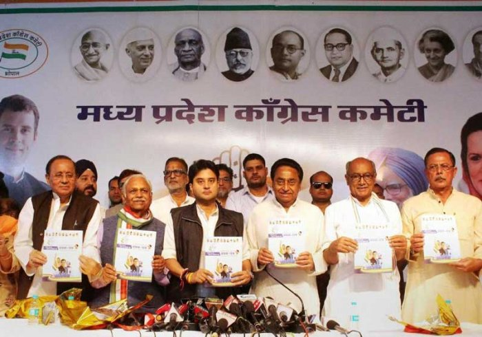 Congress state president Kamal Nath, Congress leader and MPs Jyotiraditya Scindia, Digvijay Singh, Suresh Pachouri release the party manifesto for the upcoming Madhya Pradesh Assembly elections, at PCC headquarters in Bhopal on Saturday. PTI