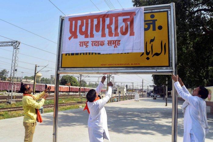 Rashtriya Rakshak Samuh activists cover Allahabad Railway Junction board with poster of 'Prayagraj' as Uttar Pradesh government Cabinet approves renaming of the city 'Allahabad' to 'Prayagraj' ahead of Kumbh Mela, in Allahabad, Oct 17, 2018. PTI
