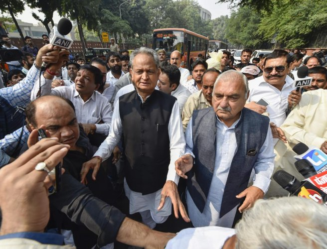 Bhupinder Singh Hooda (R) with Ashok Gehlot on Friday. PTI