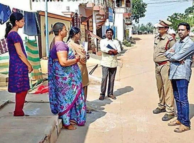 Tahasildar MS Raju and Sub Inspector Vijay Kumar meeting with women of village on Friday