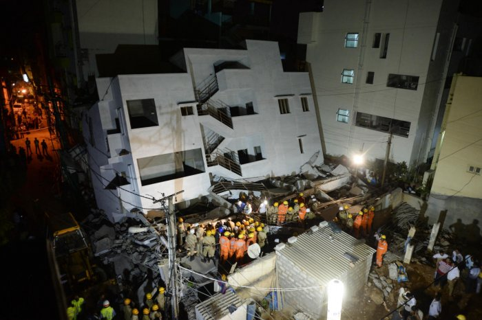 The building that tilted and collapsed on an adjacent structure in Thyagarajanagar on Saturday. DH PHOTOS/SATISH BADIGER