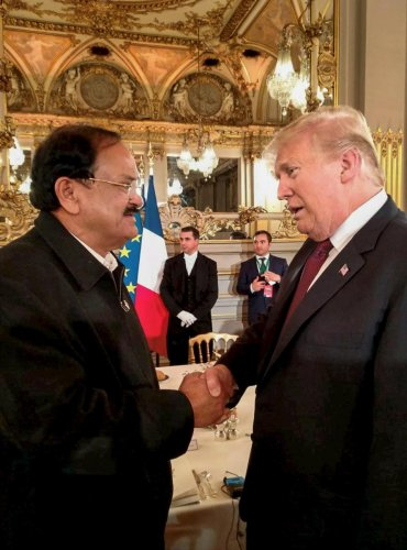 Vice President M Venkaiah Naidu meets president of the United States of America Donald Trump, at a banquet hosted by the French president, in Paris, France, on Saturday. PTI
