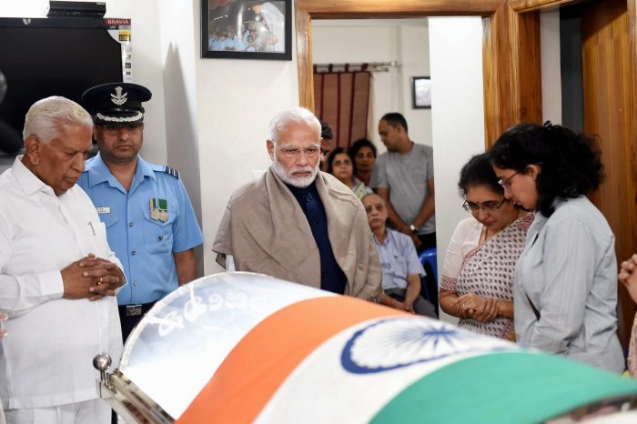 Prime Minister Narendra Modi pays his last respects to Union Parliamentary Affairs Minister Ananth Kumar in Bengaluru. PTI photo