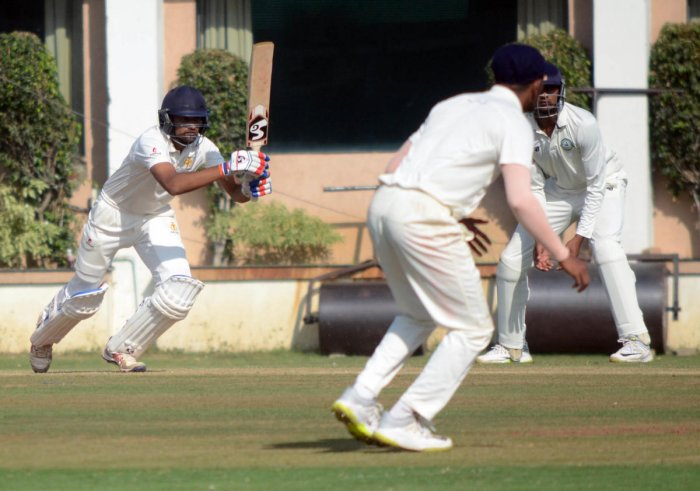 Karnataka opener D Nischal drives one to the fence during his unbeaten 66 on the second day of their Ranji Trophy match against Vidarbha in Nagpur on Tuesday. DH Photo
