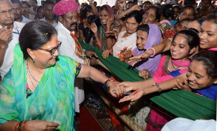 Rajasthan CM Vasundhara Raje meets people after a public meeting during 'Rajasthan Gaurav Yatra' at Kherwara, Rajasthan on Sunday. PTI photo
