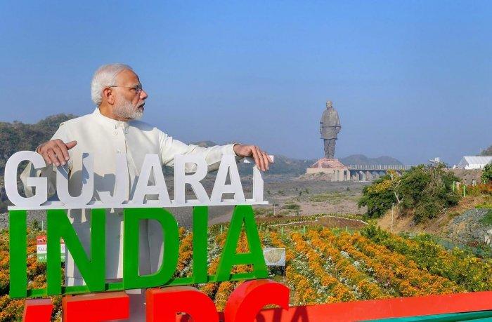 Prime Minister Narendra Modi at the inauguration of 'Valley of Flowers', overlooking the 182-metre-high statue of Sardar Vallabhbhai Patel, on the occasion of Rashtriya Ekta Diwas, at Kevadiya colony of Narmada district. PTI