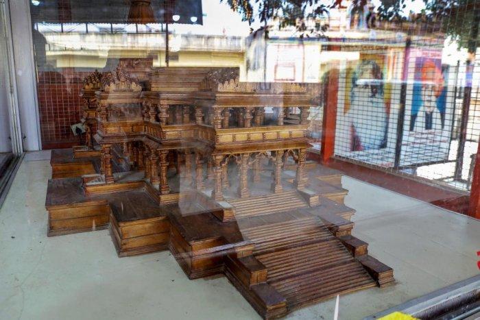 A wooden model of the 'proposed Ram temple' in a glass encasement, at the Ram Janmabhomi Nyas-run workshop at Karsevakpuram in Ayodhya, on Nov 12, 2018. PTI photo