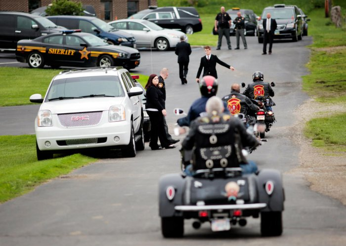 File photo: Motorcyclists from Red Knights International Firefighter Club arrive to attend a funeral for six members of the Rhoden family in rural Ohio. (Reuters)