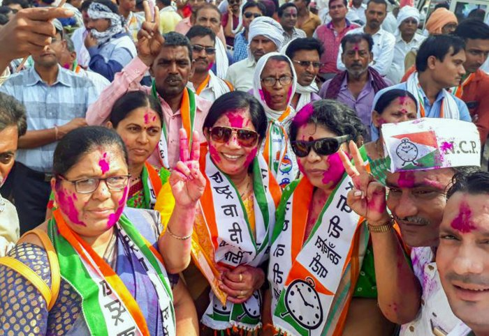 Nationalist Congress Party workers celebrate their party's success in Bhandara–Gondiya Loksabha byelections, outside their party office, in Bhandara district of Maharashtra on Thursday. PTI