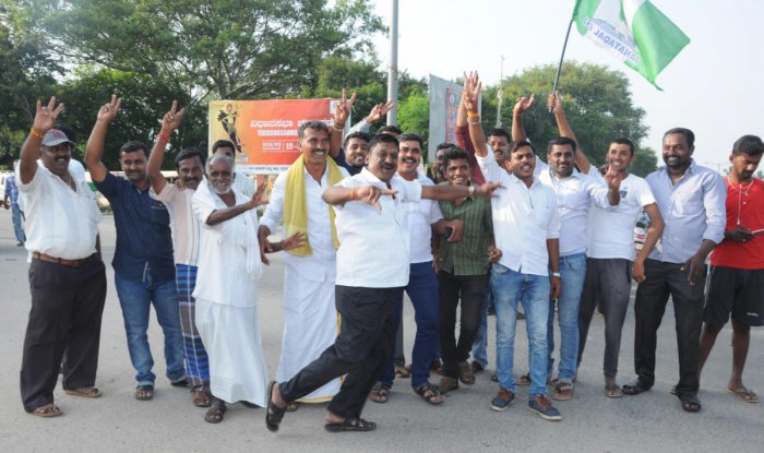 JD(S) party workers celebrate in K R Pet in Mandya district on Saturday.