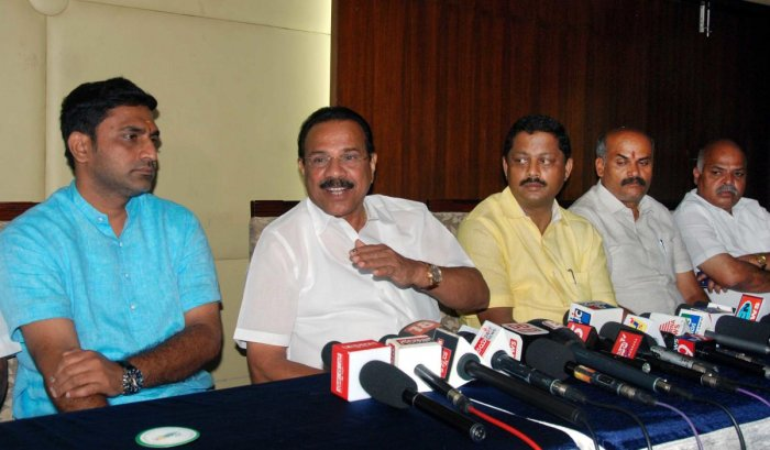 Union Minister D V Sadananda Gowda speaks about the programmes and the achievements of the Narendra Modi-led Union government in the last four years, in Hassan on Monday. MLA Preetham Gowda is seen.