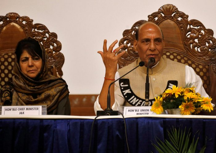 Jammu and Kashmir Chief Minister Mehbooba Mufti and Union Home Minister Rajnath Singh attend a press conference in Srinagar