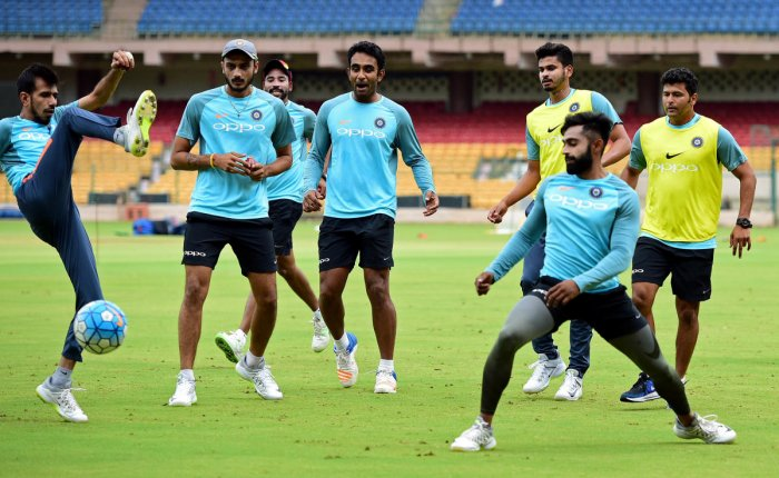BIG TEST: India 'A' players warm-up with a round of football ahead of their practice session at the Chinnaswamy Stadium in Bengaluru on Friday. DH Photo/ Krishnakumar P S