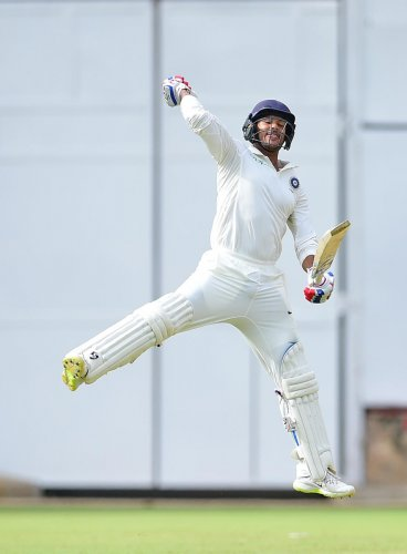 ON CLOUD NINE India 'A' opener Mayank Agarwal celebrates after reaching his double century against South Africa 'A' at the M Chinnaswamy Stadium on Sunday. DH PHOTO/ Ranju P