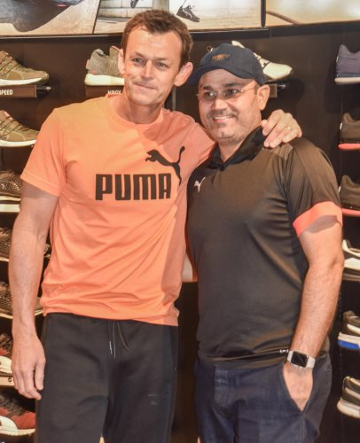 TWO OF A KIND Former Australian cricketer Adam Gilchrist (left) and former India opener Virender Sehwag at a promotional event in Bengaluru on Sunday. DH PHOTO/ S K DINESH