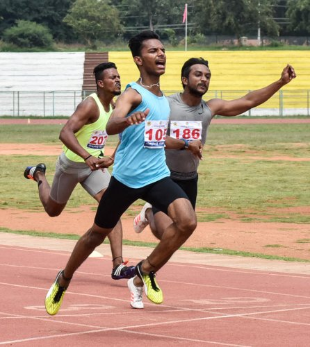 Bengaluru's Shashikanth (left) en route to victory in the 100m race at the Dasara Games athletics event in Mysuru on Tuesday. DH PHOTO/ Savitha BR