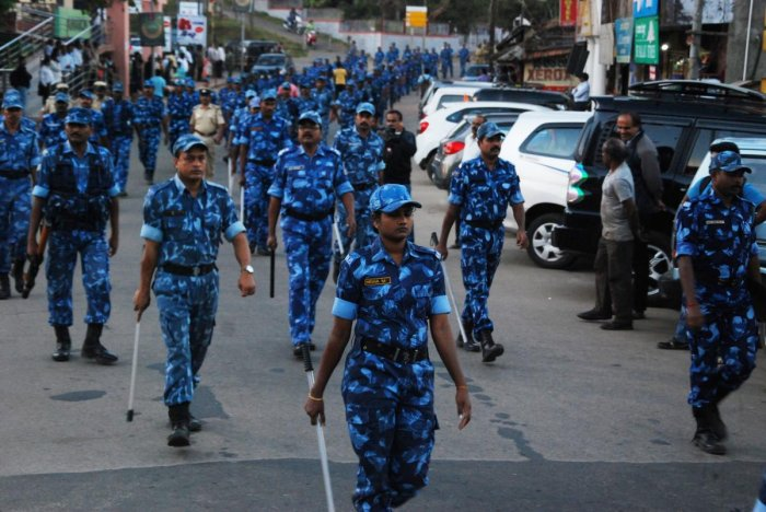 Rapid Action Force personnel take part in a route march organised to instil confidence among citizens, on the eve of Tipu Jayanti in Madikeri on Thursday. DH photo
