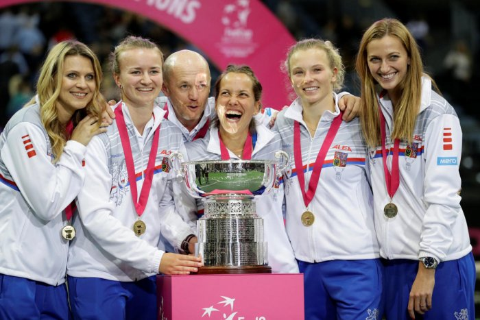 DOMINANT SHOW The Czech Republic team celebrate with the Fed Cup after blanking United 3-0 on Sunday. REUTERS