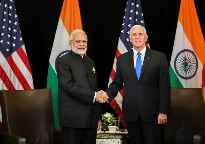 Prime Minister Narendra Modi shakes hand with the US Vice President Michael Richard Pence, on the sidelines of East Asia Summit, in Singapore on November 14, 2018. PTI