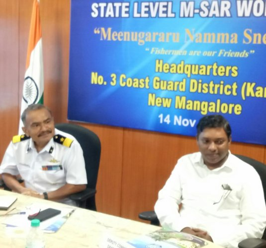 Commander Coast Guard Karnataka DIG S S Dasila and Dakshina Kannada Deputy Commissioner Sasikanth Senthil S at the first state-level Maritime Search and Rescue (M-SAR) workshop organised at the Indian Coast Guard (ICG) district headquarters near Panambur