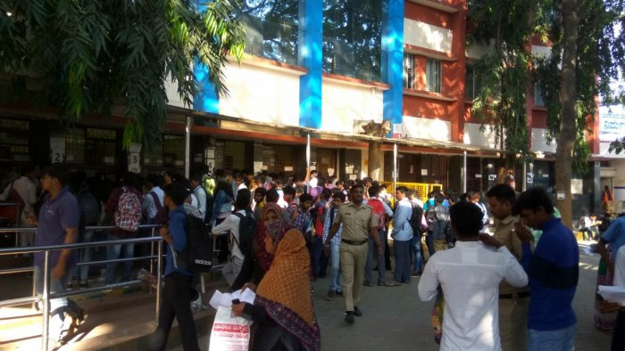 Student queue up for bus pass at the Kempegowda Bus Station in Majestic on Wednesday.DH photo