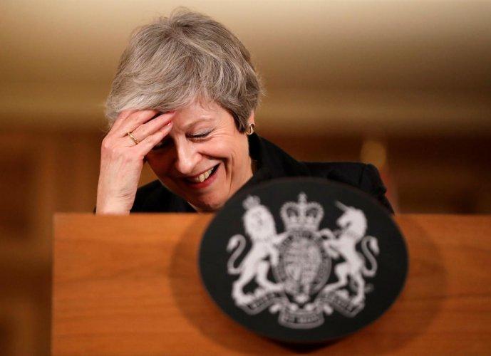 Britain's Prime Minister Theresa May reacts during a news conference at Downing Street in London, Britain November 15, 2018. (Matt Dunham/Pool via Reuters)