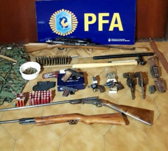 Weapons and ammunition that were found by Argentine police at the residence of two Argentine citizens with suspected links to Lebanon's Hezbollah militia are seen at the police headquarters in Buenos Aires. Reuters photo