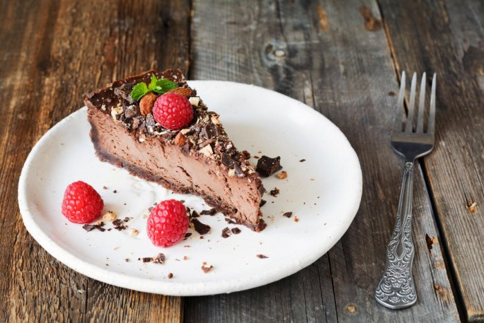 Chocolate cheescake or chocolate pie slice on white plate1