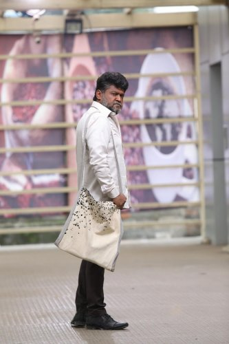 Jaggesh plays the role of a middle-aged man in '8MM Bullet'.