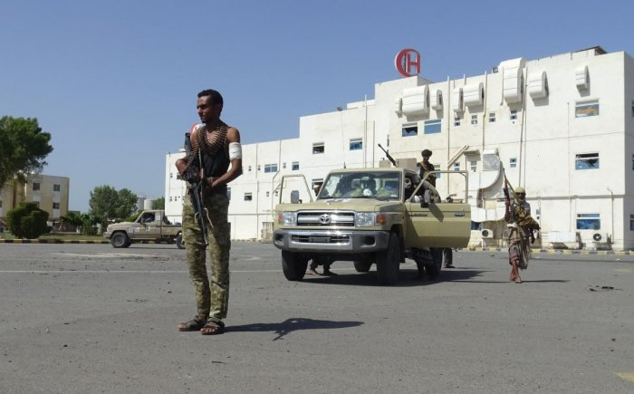 Members of the Yemeni pro-government forces gather in front of the May 22 Hospital on the eastern outskirts of port city of Hodeida. AFP