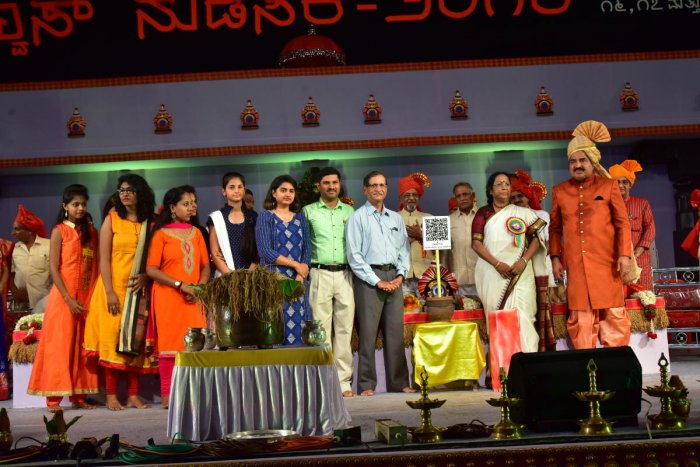 Kannada University Vice Chancellor Dr Mallika S Ghanti launches 'Shobhavana QR code project' during the inauguration of Alva's Nudisiri in Moodbidri on Friday. Alva's Education Foundation Chairman Dr M Mohan Alva, project guide U B Pavanaja and othe