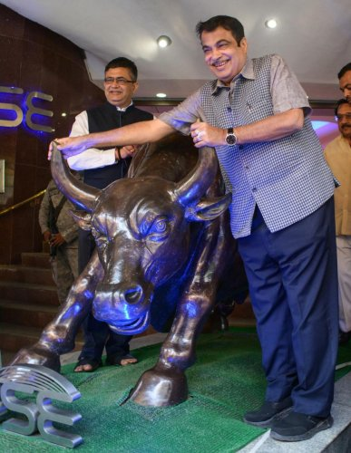 Union Minister of Road Transport and Highways Nitin Gadkari with BSE President Ashish Kumar Chauhan at Bombay Stock Exchange (BSE), in Mumbai, on Saturday. PTI Photo