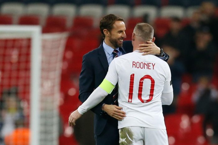 England's striker Wayne Rooney (R) is greeted by England's manager Gareth Southgate (L) after the final whistle during the international friendly football match between England and the United States at Wembley stadium in north London. AFP