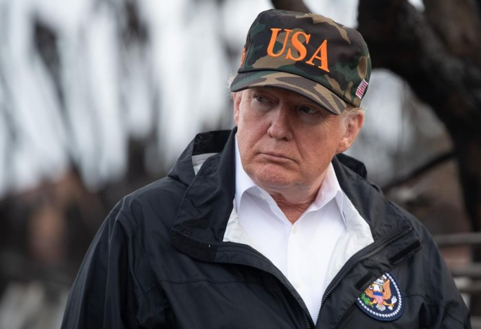 US President Donald Trump views damage from wildfires in Malibu, California. AFP