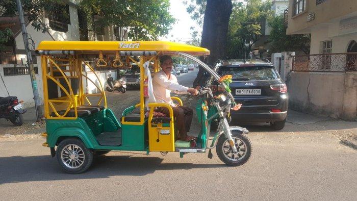 e-auto driver, Raju Vittal Pragat in his auto