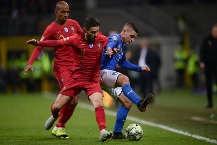 Italy's Marco Verratti (right) holds off Portugal's Bernardo Silva (centre) and Joao Mario during their match in Milan on Saturday. AFP