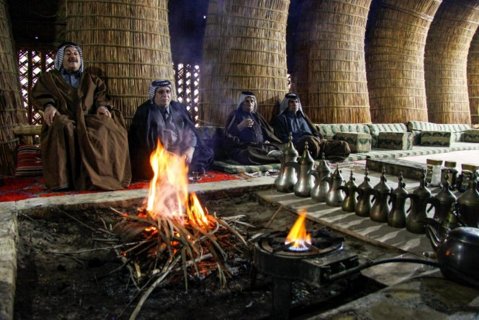 Members of an Iraqi clan gather inside a straw tent in the town of Mishkhab, south of Najaf on November 15, 2018. (AFP Photo)