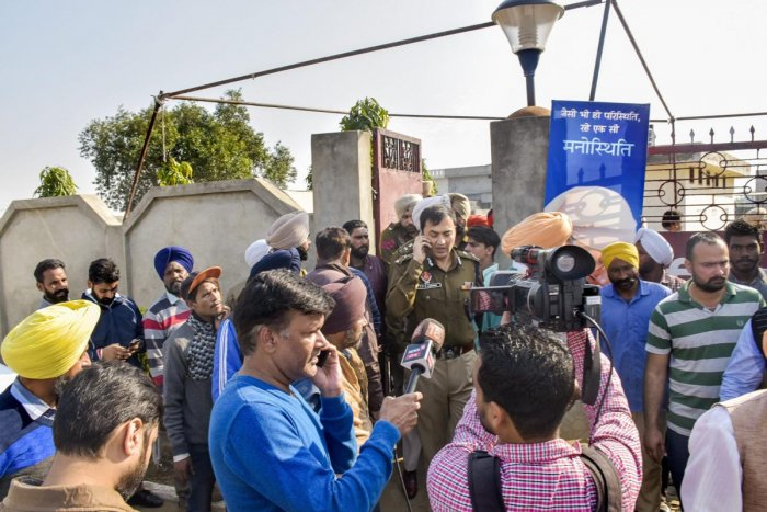Police personnel and the media at the Nirankari Bhawan, where two men on a motorcycle reportedly threw a grenade during a religious ceremony, in Rajasansi village near Amritsar, Punjab, Sunday, Nov 18, 2018. (PTI Photo)