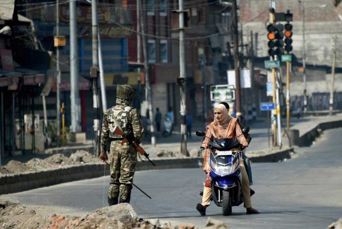Indian paramilitary trooper stops a Kashmiri motorcyclist. File photo