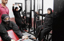 Women in burqa work out for fit, strong bodies