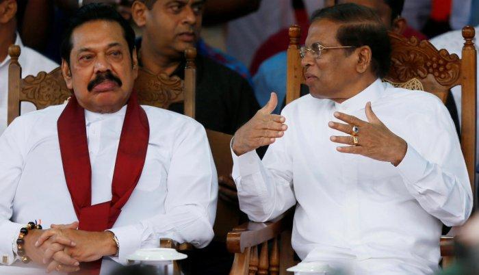 Sri Lanka's newly appointed Prime Minister Mahinda Rajapaksa and President Maithripala Sirisena talk during a rally near the parliament in Colombo, Sri Lanka November 5, 2018. (REUTERS File Photo)