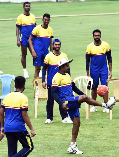 Karnataka players at a training session on the eve of their Ranji Trophy match against Mumbai in Belagavi. DH photo/ Tajuddin Azad