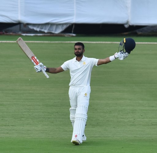 Karnataka's K V Siddharth celebrates after reaching his maiden first-class ton against Mumbai in Belagavi on Tuesday. DH PHOTO/TAIJUDDIN AZAD
