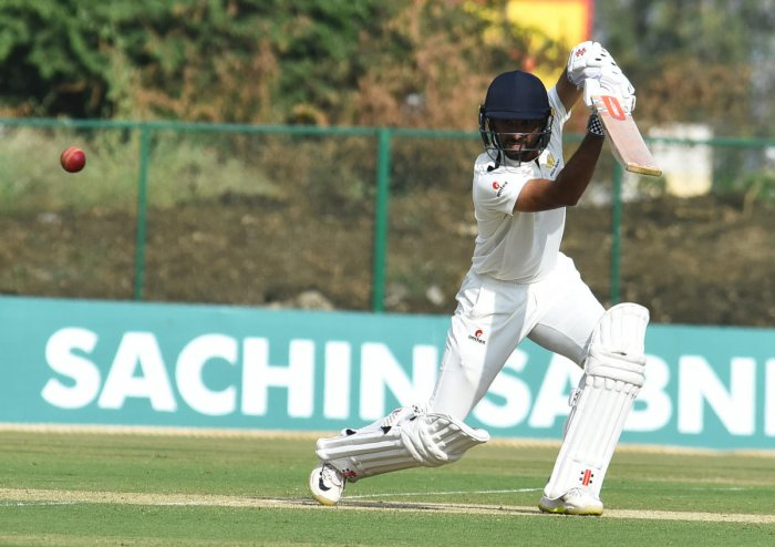 FETH THAT!: Karnataka's KV Siddharth drives one to the fence during his unbeaten ton against Mumbai on Tuesday. DH PHOTO/ TAJUDDIN AZAD