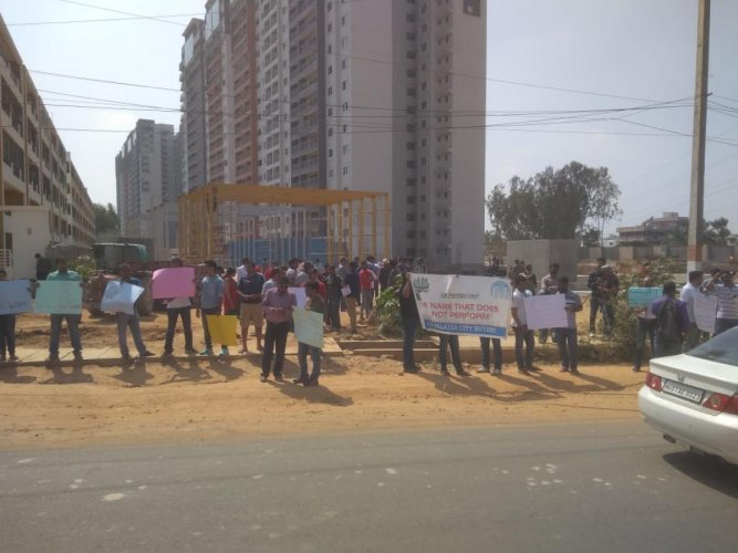 More than 75 buyers protest against the builder for delay in handing over the flats.