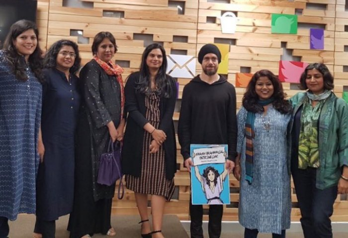 """Twitter CEO Jack Dorsey with a poster saying """"Smash Brahmin Patriarchy"""" poses for a photo. (Credit: Twitter)"""
