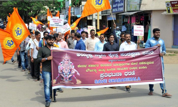 Ayyappa Swamy Kshethra Rakshana Samithi members take out a procession in Chikkamagaluru on Tuesday.