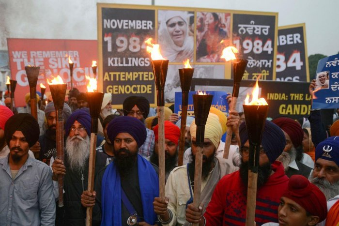 (FILES) In this file photo taken on November 3, 2018 Indian activists of the Dal Khalsa radical Sikh organization march at a protest to commemorate the 1984 anti-Sikh riots in Amritsar. - An Indian court on November 20, 2018 handed down first death penalt