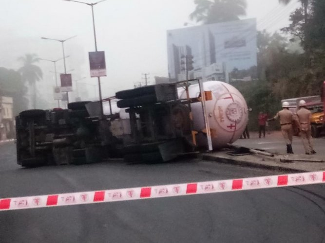 The oil tanker that skidded off the road near Mangaluru on Wednesday. DH Photo.